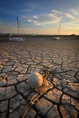 Broken Land.... (Digital Diary........) Tags: uk beach broken liverpool boats mood mud dry cracks cracked wirral bonedry goodlight sheldrakes brokenland