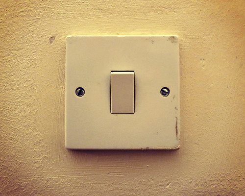 light switch warm glow grubby