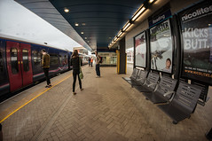 Back to reality (Мaistora) Tags: new uk boy england people girl station mobile architecture train walking advertising poster reading media waiting phone britain contemporary travellers platform railway wideangle terminal passengers fisheye commute advert soy shelter canopy 8mm berkshire ultrawide firstgreatwestern commuters browsing 288 texting lightroom nex thamesvalley samyang fgw maistora 5r