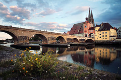 Steinerne Brcke (Youronas) Tags: city bridge flowers reflection stone canon buildings reflections river germany bayern deutschland bavaria cityscape cathedral dom medieval unesco 7d brcke fluss regensburg ratisbon stonebridge unescoheritage ratisbona 1585 castraregina canon7d canon1585