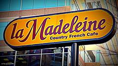 la Madeleine (Thad Zajdowicz) Tags: sign letters color urban city street business zajdowicz bethesda maryland leica dlux3 usa outdoor outside signboard text shop writing