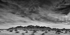 west riverside mountains. mojave desert, ca. 2014. (eyetwist) Tags: eyetwistkevinballuff eyetwist westriversidemountains west riverside mountains range clouds cloudporn bw blackwhite black white monochrome mojavedesert mojave desert arid dry ca62 highway 62 vidaljunction vidal junction jct rice pano panorama sky nikon nikond7000 d7000 nikkor 18200mmf3556gvrii socal california processed photoshop postprocessed postprocessing filter nik contrast stitched silver efex silverefex panoramic landscape southwest wide silverefexpro america bigsky open grommet needles blythe mountain american