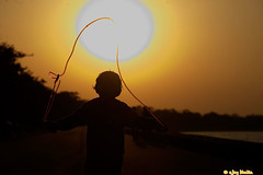 Anadya and the Sun (AJAY BHATIA photography) Tags: sun childhood child dreams skipping sukhnalake nikon80200mmf28afdnikkored