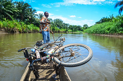 Down the Longa river on a canoe (jbdodane) Tags: africa bicycle river cycling boat published canoe velo pirogue angola cyclotourisme cycletouring day471 alamy riolonga freewheelycom camdombo alamy150731