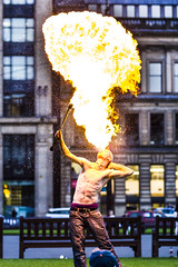 Ross 2 (ali mckellar) Tags: show canon square fire george crazy circus glasgow hippy 85mm georgesquare flame flamethrower pyro firebreather paraffin pyrotechnic 550d 85f12 playwithfire circusfolk fireperformer
