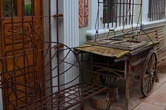 The Iron Market (MPnormaleye) Tags: door wood windows arizona southwest tile wagon wooden desert seat utata grille stucco ironworks
