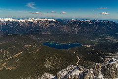The view from Germanys highest mountain (nureco) Tags: travel blue trees winter light summer sky sun mountain lake snow mountains alps tree green water clouds forest germany landscape bayern deutschland bavaria see state free garmischpartenkirchen eibsee zugspitze alpz nureco