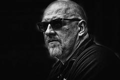 Cool man (Steve Greene Photography) Tags: street urban blackandwhite man monochrome sunglasses candid streetphotography jazz cheltenham nikond40