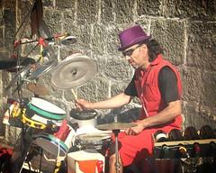 le drummer colo... (mariej55quebec) Tags: red people musician music woman man rouge artist femme crowd foule homme gens musique artistes vieuxqubec spectacle jongleur musicien acrobates artistesderue amuseurs