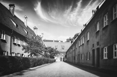 """In der Fuggerei"" (helmet13) Tags: leicaxvario bw fuggerei augsburg buildings socialhousingcomplex architecture dignity sociallyunderprivileged humanity jakobfugger generousness history aoi heartaward peaceaward platinumpeaceaward 100faves world100f"