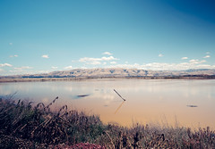The Wetlands of Alviso, CA (Zrave) Tags: california park county travel blue sky brown mountains nature water clouds marina bay long exposure fuji area wetlands 12mm wilderness alviso southbay samyang xpro2