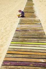 Hot Sand (Larrie Barlow) Tags: beach bucket sand child decking barlow spade larrie
