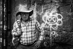 flower cowboy (MarioMancuso) Tags: life road street city light people urban bw italy white black monochrome photography mono italian italia noir shot streetphotography documentary mario scene bn naples fujifilm streetphoto reportage monocrome photogrphy mancuso