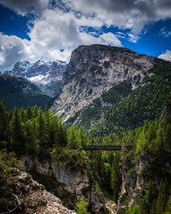 Cortina d' Ampezzo Bridge (D. Scott Taylor) Tags: cortina italy alps mountains bridge trees landscape sky blue clouds green
