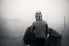 Dreaming (Piyush_Goswami) Tags: travel winter bw india photography documentary ganges allahabad photostory kumbhmela outofthefog 2013 piyushgoswami