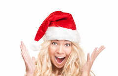 Surprised girl in red santa hat isolated on white. (Konstantin Yolshin) Tags: santa christmas new xmas winter red portrait people woman white holiday cute girl beautiful beauty face hat lady female mouth fun happy person one navidad pretty hand open emotion background year joy young happiness excited celebration cap delight blonde attractive surprise shock surprised claus cheerful gesture joyful isolated amazed caucasian