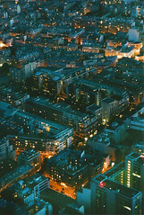 the city lights shine (Rob Aparicio) Tags: street city blue roof light paris france streets film canon buildings 50mm lights calle edificios europa europe eiffeltower ciudad citylights torreeiffel francia calles techo pars 50mm18 techos tumblr canoneos1000d viewsfromtheeiffeltower robaparicio robertoaparicio robaparicioflickr flickrtotumblr