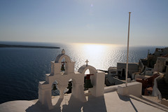 Silhouetted bell tower (Ben936) Tags: shadow sea tower island mediterranean bell flagpole oia settingsun