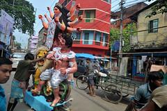 Kumortuli :Potters district, Kolkata during Durga puja celebration (E R) Tags: travel india art heritage religion traditionalart idol kolkata sari bengal calcutta artisan ganga durgapuja rituals westbengal indianart travelindia indianfestivals gangariver indianwoman indiatravel riverganga hindugod indianfestival streetsofcalcutta festivalsofindia hindurituals goddessdurga northkolkata bengalart kumartuli bengaligirls pujapandal hinducelebration calcuttaindia streetsofkolkata mothergod kolkatastreets durgaidol westbengaltourism kumortuli idolmaking womaninsari bengalifestival bengalifestivals kolkatakumartuli hindudecoration bengaltradition bengalicelebration bengalhistory bengaltravel artistofkolkata westbengalpolitics kolkatafestival clayidolmaking poorartists pottersdistrictkolkata fesivalofgoddessdurga bengalidecoration celebrationofgoddessdurga indiandrape bengalitraditionalware bengaligirlsintraditionalsari bengalitraditionaldress