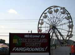 Richland County Fair. (dccradio) Tags: carnival sky festival wisconsin fun streetlight ride fair pole powerlines entertainment lamppost wires ferriswheel rides chance midway countyfair wi lightpole amusements electricwires carnivalride thrillride electriclines mreds amusementride communityevent fairride richlandcenter richlandcounty richlandcountyfair mechanicalride carnivalmidway centurywheel chancemanufacturing chancerides chancemfg mredsmagicalmidway mredscarnival chanceindustries richlandcenterfair