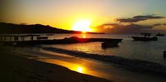 Coconut Beach Sunset (Grand Anse, Grenada) (Bidwell, Coby) Tags: cameraphone ocean sunset sea sky sun reflection beach apple silhouette yellow boats bay fishing dock grenada caribbean goldenhour iphone grandanse coconutbeach iphone4