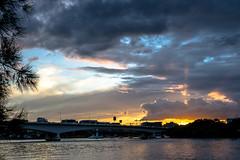 Sundown (Norma Martiri) Tags: nightphotography bridge sunset cloud skyscraper river cityscape australia brisbane nightscene brisbaneriver cityskyline waterscape