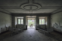Waiting Room (Subversive Photography) Tags: light castle abandoned hospital ruins beds decay wheelchair memories atmosphere symmetry urbanexploration melancholy sanatorium manor derelict hdr urbex sanitorium