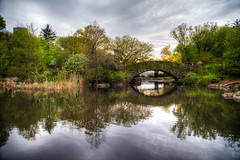 Gapstow Bridge in Central Park (Daniel Portalatin Photography) Tags: trees sunset lake ny newyork art water clouds canon landscape photography spring cityscape dusk path centralpark fineart scenic sly reflextion gapstowbridge