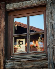 Gruss Gott (chrisotruro) Tags: wood blue red orange brown reflection bird texture window glass june pine sunrise dawn austria amber midsummer heart eagle grain alpine summarit50mm515