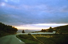 Virage (Guillaume Gaubert) Tags: ocean road sunset sea wild sky sun france mountains film nature car youth clouds analog 35mm french landscape island view roadtrip wanderlust adventure explore indie van ontheroad wander