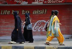 Muslim and Hindu women (Rick Elkins Trip Photos) Tags: woman india walking advertising women muslim religion bangalore beverage coke cocacola karnataka hindu burqa burkha salwarkameez burka bourkha chadri