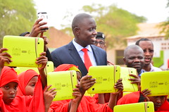 Proudly holding the digital learning tablets
