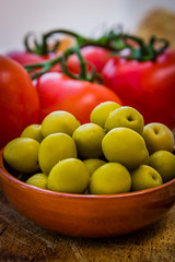 Olives and Tomatoes (King Grecko) Tags: travel red stilllife food detail macro green texture vegetables fruit tomato lunch healthy spain mediterranean tomatoes olive vine bowl spanish tapas olives diet tomatos 2470f28 terracottabowl gastonomy canon5dmk3
