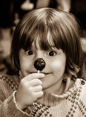 Tootsie Pop Eyes (oliemackeral) Tags: boy bw monochrome smile sepia youth hair sweater eyes long child pop tootsie