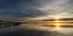 Bavarian Sunset (hjuengst) Tags: blue sunset panorama orange reflection bayern bavaria sonnenuntergang jetty peaceful bluesky calm spiegelung blauerhimmel chiemsee steg reflektionen ruhig