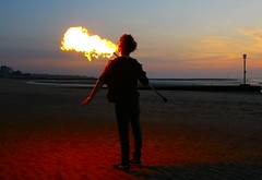 Fired up (Graham  Sodhachin) Tags: sunset beach fireeater