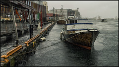 Docked on a wet day (Vardetangenfilm) Tags: city wet rain by clouds boats boat wooden day quay bergen docked hordaland fjords vann vgen vestlandet bergennorge norwaybergen vardetangen vardetangenfilm