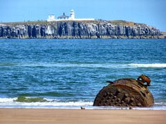 Boiler and Lighthouse (Northern Dave) Tags: leica blue sea sky lighthouse beach st lens island lumix golden coast seaside sand rust rocks ship dunes tide ships aidans north cliffs inner panasonic northumberland shipwreck coastline bamburgh farne corrosion boiler ebb seahouses bythesea fz38 dmcfz38