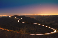 Map to the stars (DirtyBootPrints) Tags: road light sunset cliff mountain motion mountains beauty car night stars landscape flow lights dance movement view horizon small hill wave curvy headlights nightlight environment lighttrails curve overlook wavy exposed startrails lightrays