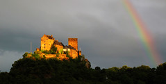 Schnburg Castle under a Rainbow (Batikart) Tags: city travel blue trees light shadow summer vacation sky house holiday mountains color colour green tower castle nature weather wall architecture clouds forest canon germany dark landscape geotagged deutschland town rainbow europa europe peace sommer urlaub natur sightseeing wolken tranquility medieval illuminated unescoworldheritagesite berge stadt recreation relaxation ursula turm rhine landschaft regenbogen burg reise rheinlandpfalz sander mittelalter beleuchtet middlerhine rhinelandpalatinate mittelrhein 100faves oberwesel schoenburg 2013 200faves viewonblack rhinegorge schnburg batikart schnburgcastle canonpowershotg11