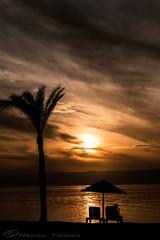 Aqaba bay sunset (Hannu Tiainen Photography) Tags: sunset sea sky sun beach clouds bay gulf redsea palm jordan palmtree aqaba talabay