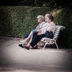 Solamente Porque (Bokehneer) Tags: madrid ladies friends cane garden dark bench spain women sitting moody friendship profile elderly oldwoman resting amigas mutedcolors vignette madres hedges