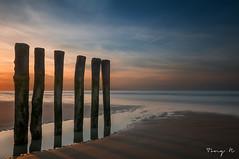 Blriot Plage, Calais ... (Tony N.) Tags: sunset sea bw orange mer france beach sand sable bleu nordpasdecalais plage stakes calais nord coucherdesoleil blriot nikkor175528 bwnd110 pieus d300s blriotplage