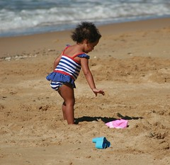 Beach! (earthly magic) Tags: ocean summer sunlight beach water girl hat sunshine hair fun sand toddler holidays play stripes earring australia curly innocence queensland reach ethnic addorable