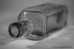 Shallow Bottle (Nick Biswell) Tags: blackandwhite macro glass monochrome bottle shallowdof glassbottle buckinghamcameraclub bccpoty2014round4open