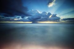 Cowrie Hole (Leighton Wallis) Tags: cloud sun beach rain sunrise newcastle dawn sand surf sony australia filter lee nsw newsouthwales rays alpha f40 1635mm newcastleoceanbaths cowriehole mirrorless a7r bigstopper emount ilce7r