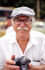 Anonymous 011 (Bruno Da Silva) Tags: street brazil portrait people man film analog 35mm glasses photographer sopaulo streetphotography oldman anonymous canoneos5 kodakgold200 brunosilva 50mmf18ii filmisnotdead