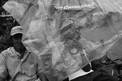 147/365 (Nico Francisco) Tags: street blackandwhite man rain umbrella plastic cover 365 366
