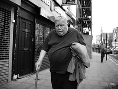 "London Black and White Street Photography - ""The Great Londoners"" (Nicholas Goodden) Tags: people monochrome cane candid voigtlander streetphotography oldman olympus walkingstick shotfromthehip manualfocus kentishtown blackandwhitephotography urbanphotography londoners peopleonthestreets manuallens blackandwhitestreetphotography londonphotography microfourthirds omdem1"