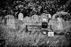 Patience (Hugh Rawson) Tags: godalming streetphotograph grave monochrome church street woman mono streetphotography bw urban blackandwhite uk surrey